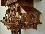 The Side of an Anton Schneider Cuckoo Clock with a Typical Brauhaus Scene Including Tapping a Keg