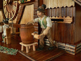 A Brewer in a green Jacket tapping a Keg at the Brauhaus on an Anton Schneider Chalet Cuckoo Clock