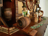 Bavarian Man in green Jacket rolling a Keg into the Brauhaus on a Schneider Black Forest Cuckoo Clock