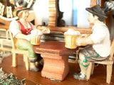 Bavarian Couple Drinking Beer, one sip for each Cuckoo, on a Schneider Chalet Black Forest Cuckoo Clock