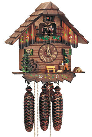 Schneider Cuckoo Clock with a Man Chopping Wood, a Water Wheel, and a Bench in front of a Fir Tree