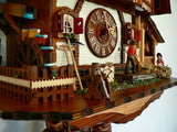 Water Wheel with Farming Tools and a Girl and a Man on Schneider Chalet Black Forest Cuckoo Clock