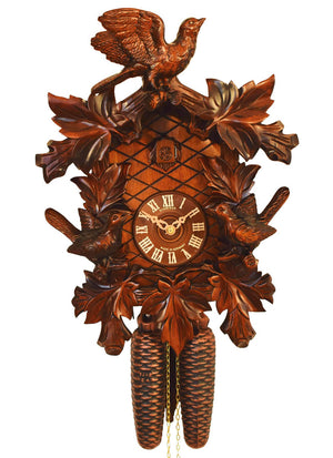 Three Birds frame the face of a Anton Schneider Traditional German Cuckoo clock with Ivy leaves.