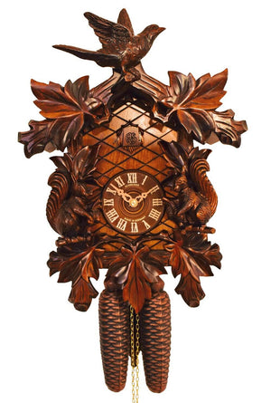 a Bird landing on a Schneider Traditional German Black Forest Cuckoo Clock almost disturbing the two Squirrels framing the Dial of the Clock