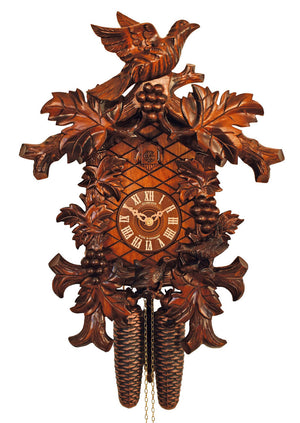 A Bird spreading its wings sitting on a Schneider Traditional Black Forest cuckoo Clock with Grapes hanging between Vine Tendrils