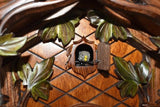 Cuckoo Bird looking out of his door surrounded by Ivy Leaves on a Traditional Schneider Cuckoo Clock
