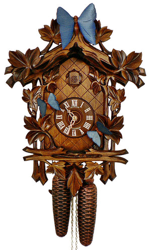 Three Blue Butterflies on vines of Ivy Leaves on a Schneider Traditional Black Forest Cuckoo Clock