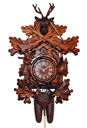 Two Rifles hanging on the head of a stag. Underneath are a hunted pheasant and rabbit. Right under the Dial of the Schneider Black Forest Cuckoo Clock is the hunting bag.