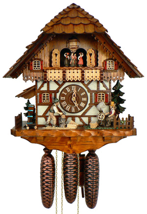 German Man chopping Wood and his Wife spinning Wool on Schneider Chalet Black Forest Cuckoo Clock