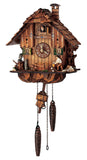 An Owl on a Tree Stump watching a Bavarian Woodchopper on a Schneider Chalet Black Forest Cuckoo Clock