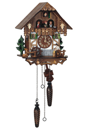 Woodchopper in Bavarian Clothes in front of a Half-Timbered Schneider Chalet Black Forest Cuckoo Clock