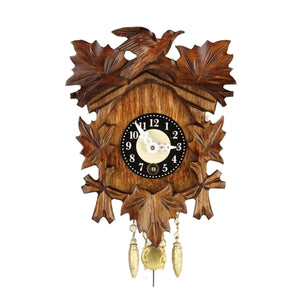 Five Leaves and a Cuckoo Bird on an Engstler Key Wind Up Clock with brass colored Pendulum