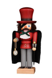 From the German story the Nutcracker and the Mouse King, comes Uncle Drosselmeier. This hand carved Christian Ulbricht Nutcracker is wearing his trademark eyepatch, a large red top hat, red jacket and his gold watch and chain. Over his jacket he is wearing a black cape. He is carrying a black cane topped with a golden circular handle