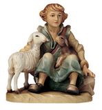 Shepherd sitting with sheep