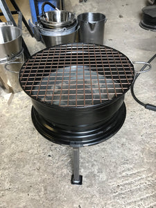 Bbq and steel wheel firepit.
