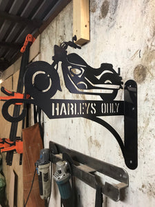 Harleys Only wall mounted raw metal sign.