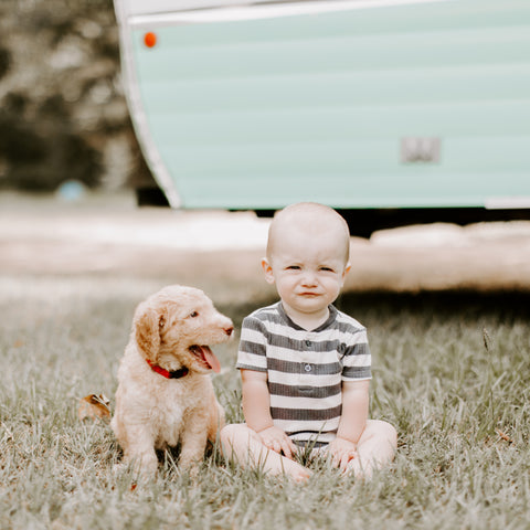 A boy and his goldendoodle puppy. Dacus Doodles