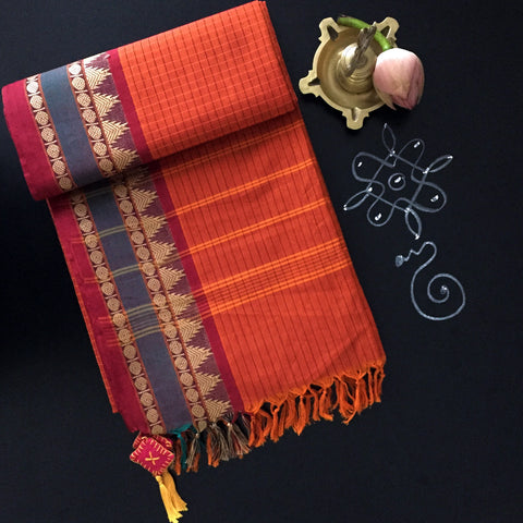 chettinad cotton saree: sunset orange checks & temple border