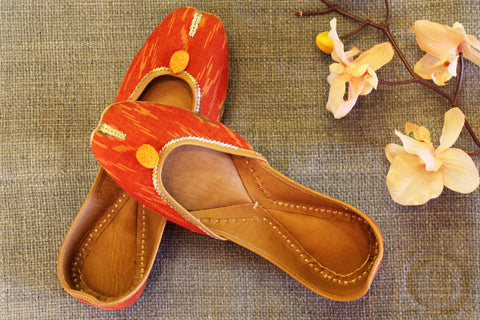 handcrafted juttis: orange & ikat
