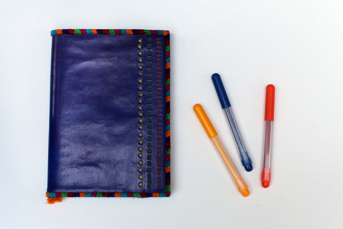hand punched leather diary - purple & multi-color