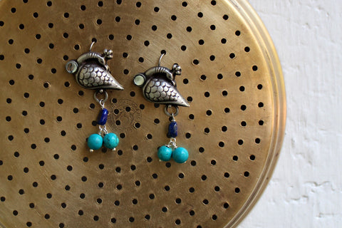 silver jewelry - turning peacock with blue beads