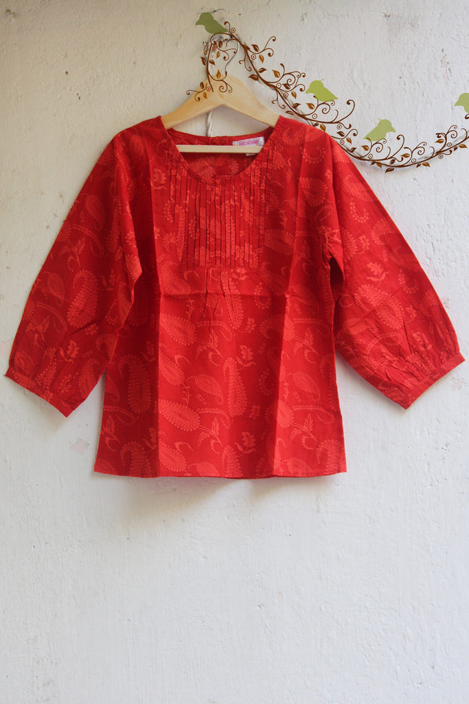 kidswear - red orange pintuck top