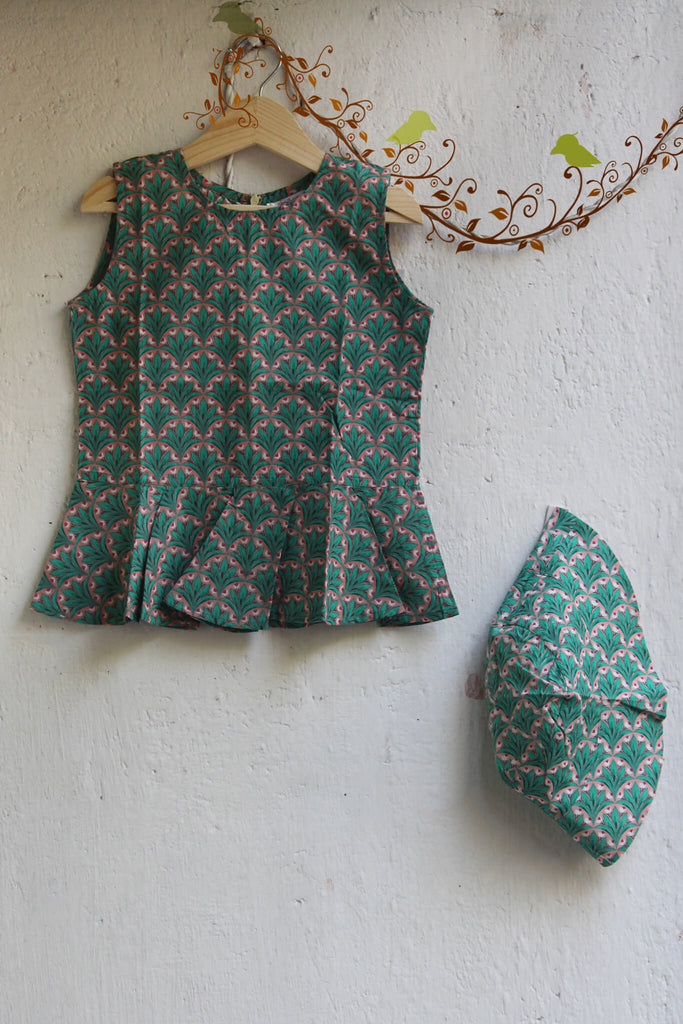 kidswear - green peplum top with hat