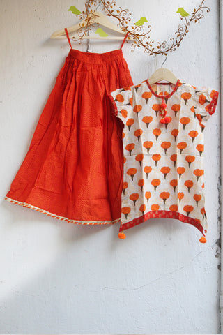 kidswear - orange lehriya lehenga with orange genda phool top