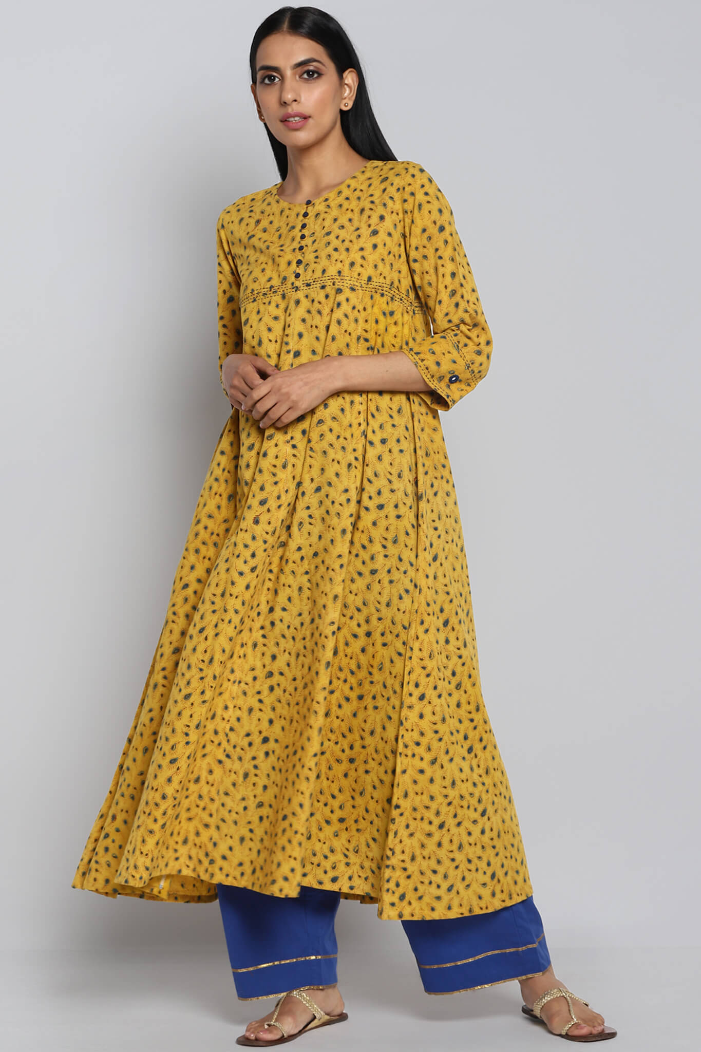 Hand block printed yellow ajrakh with indigo motifs cotton anarkali with round neck and cream hand embroidery and mirror work on  bust and border