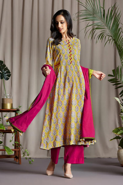 Bright Yellow Floral Buta Anarkali with Handloom Ikat Patti Side patti and Sleeve Cuff with Mashru Silk handmade Potli buttons and hand embroidery on Neck Patti and Side trims with Pink Mul Dupatta