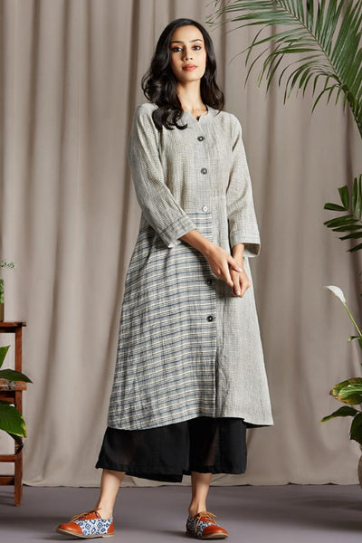 A line panel dress with Kala cotton with white black micro checks, and Indigo grey check patch and hand hemmed neckline and hemline and metal blazer buttons