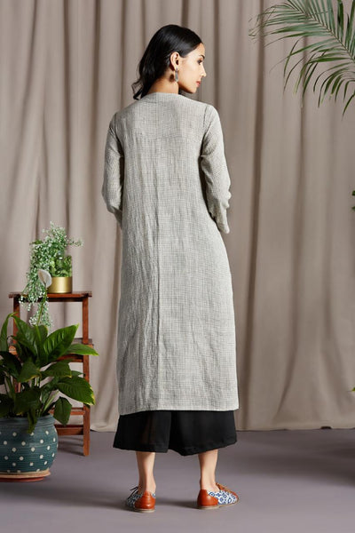 A line panel dress with Kala cotton with black micro checks, and Indigo grey check patch and hand hemmed neckline and hemline and metal blazer buttons