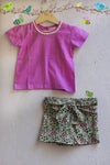 kidswear - white shorts with purple top