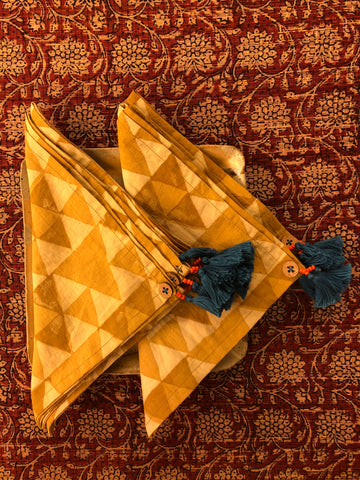 dinner napkins - ochre yellow triangle & blue tassels