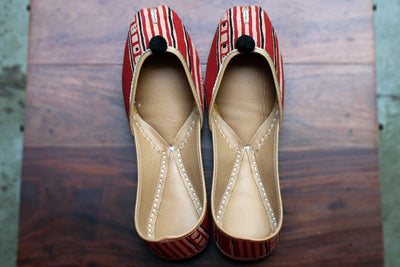 handcrafted juttis: red brush & black ink