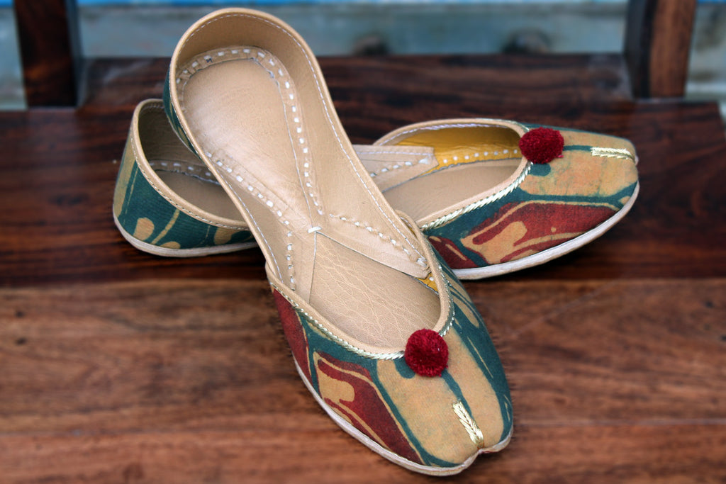 handcrafted juttis: ajrakh & yellow clay
