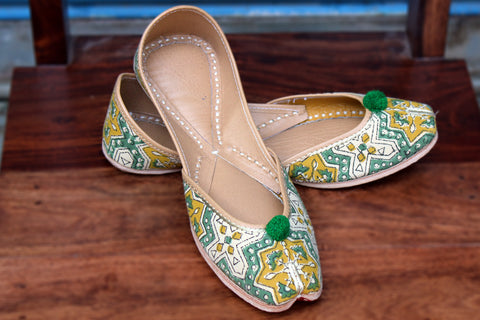 handcrafted juttis: yellow star & green bud