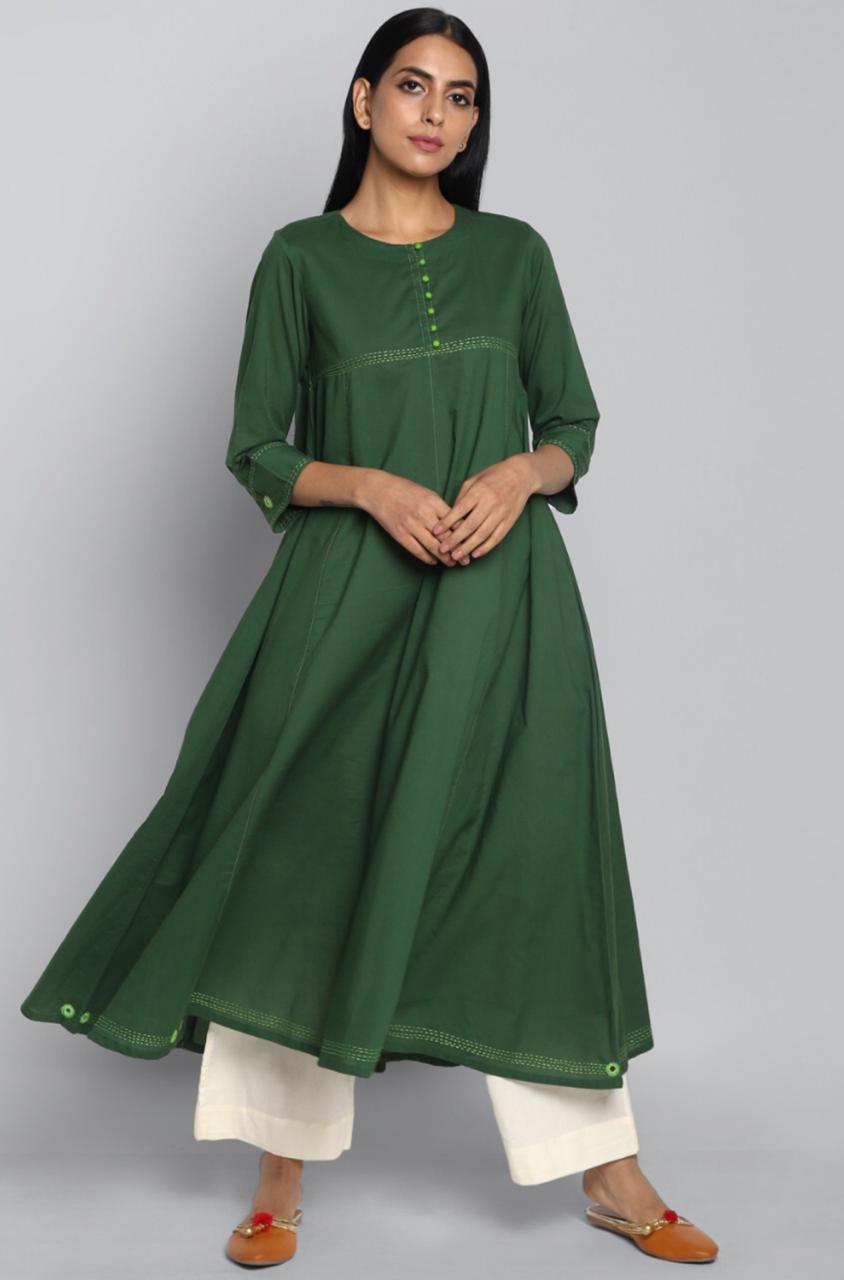 Deep green cotton  cotton anarkali with round neck and cream hand embroidery and mirror work on  bust and border