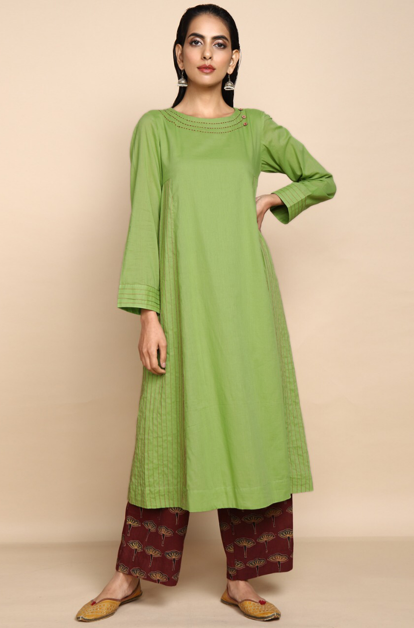 leaf green mul kurta with lining with golden embroidery at the neck and madder red ajrakh botanical print straight pants