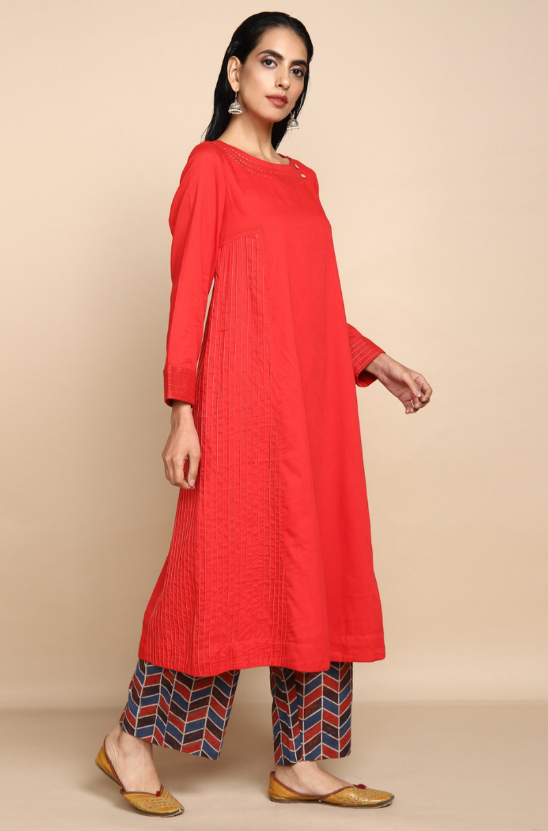 bright red mul kurta with lining with golden embroidery at the neck and wine red indigo ajrakh print straight pants