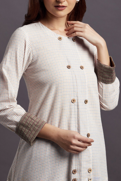 A line cotton round neck Kurta in white with micro checks in orange and blue and front wooden buttons and blue pants
