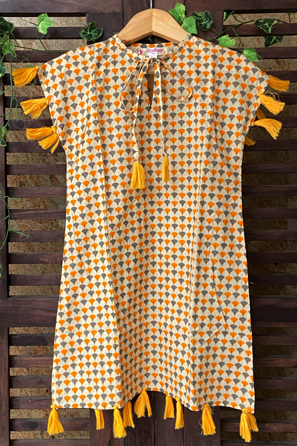 kidswear - orange dress with orange tassels