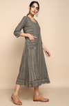 Ajrakh grey indigo zigzag cotton knee length dress, round neck with black stripes with ruffle bottom panel and patch square pockets with button detail