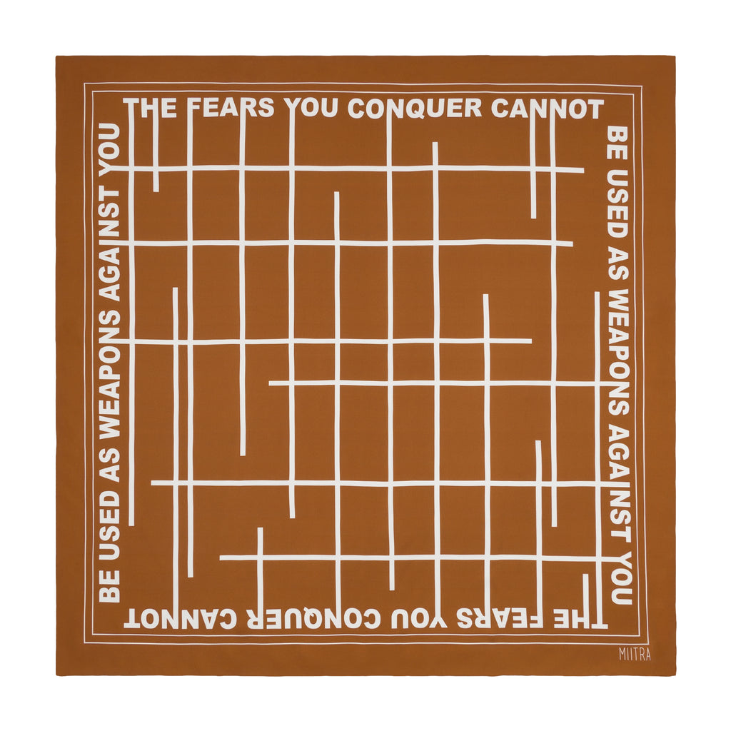 Brown silk scarf that says the fears you conquer cannot be used as weapons against you