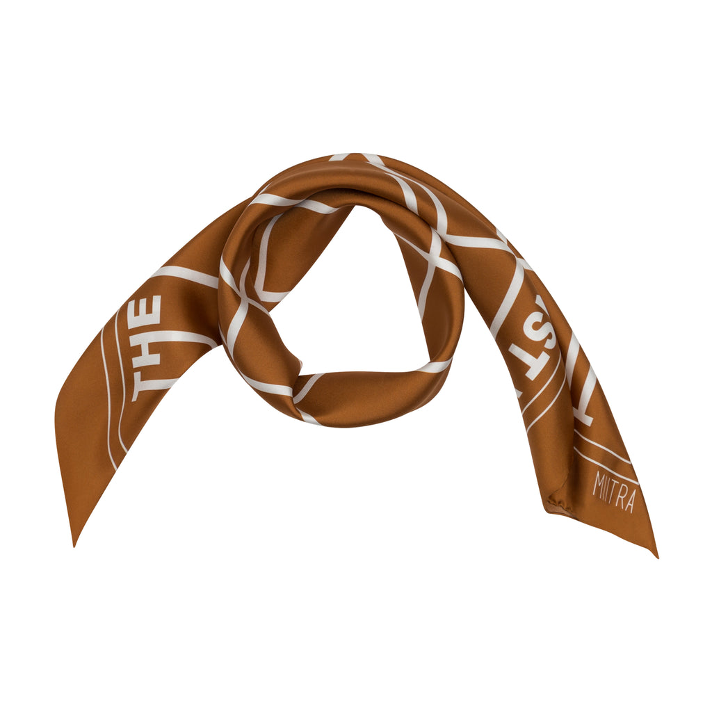 Styled view of a brown silk scarf wrapped around in a circle