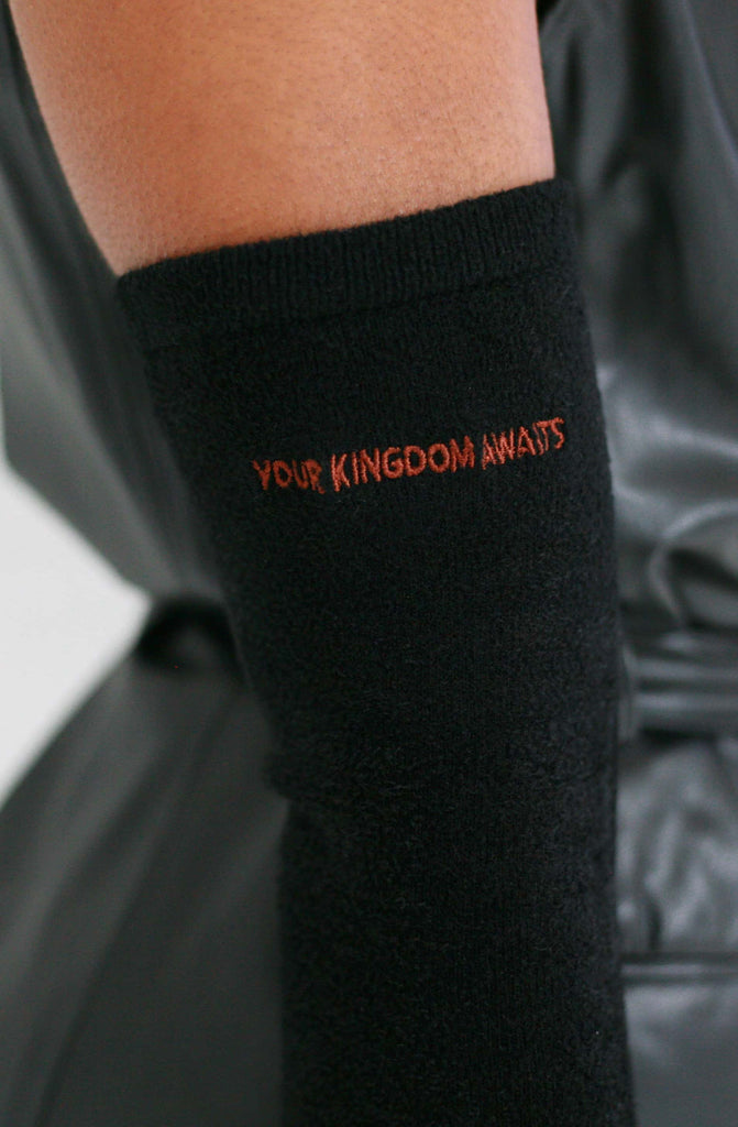 Black gloves that say your kingdom awaits