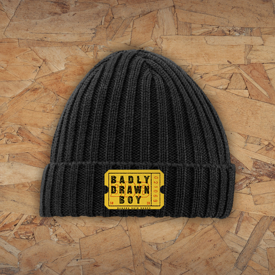 Beanie with embroidered ticket design