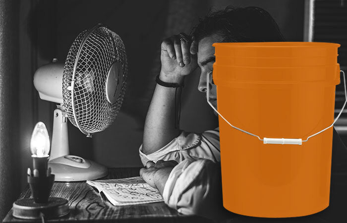 Person with a fan and bucket