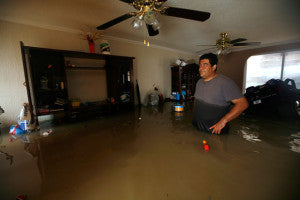 Flooded House via Telegraph - Texas