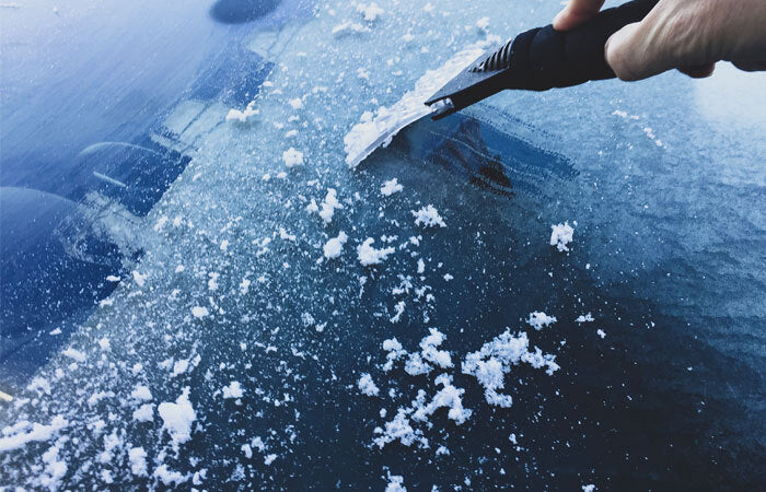 scraping ice off a windshield